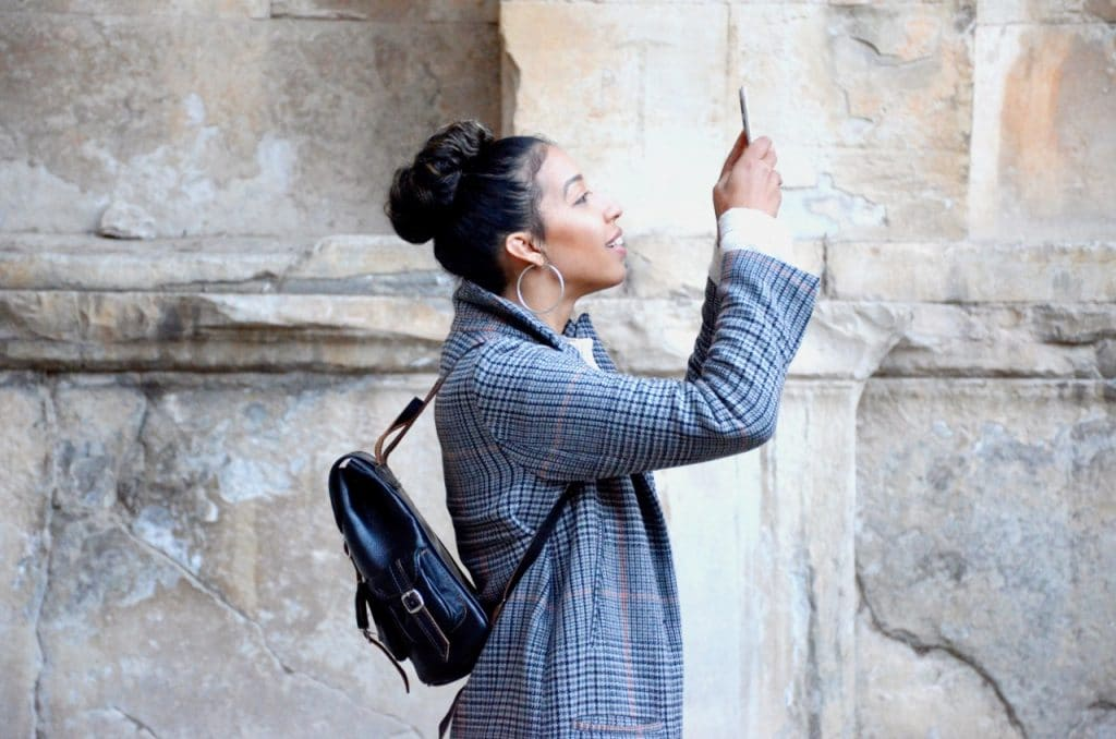 Woman taking a video with a smart phone